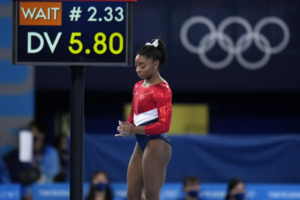 Simone Biles, of the United States, waits to perform on the vault during the artistic gymnastics women's final at the 2020 Summer Olympics, Tuesday, July 27, 2021, in Tokyo. The American gymnastics superstar has withdrawn the all-around competition to focus on her mental well-being. (AP Photo/Gregory Bull)