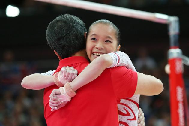 LONDON, ENGLAND - AUGUST 06:  Kexin He of China reacts after competing in the Artistic Gymnastics Women's Uneven Bars final on Day 10 of the London 2012 Olympic Games at North Greenwich Arena on August 6, 2012 in London, England.  (Photo by Ronald Martinez/Getty Images)