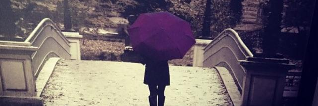 Woman with purple umbrella.
