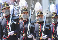 Belgium's Crown Princess Elisabeth, second left, marches with cadets of the military school past the Royal tribune during the National Day parade in Brussels, Wednesday, July 21, 2021. Belgium celebrates its National Day on Wednesday in a scaled down version due to coronavirus, COVID-19 measures. (Laurie Dieffembacq, Pool Photo via AP)