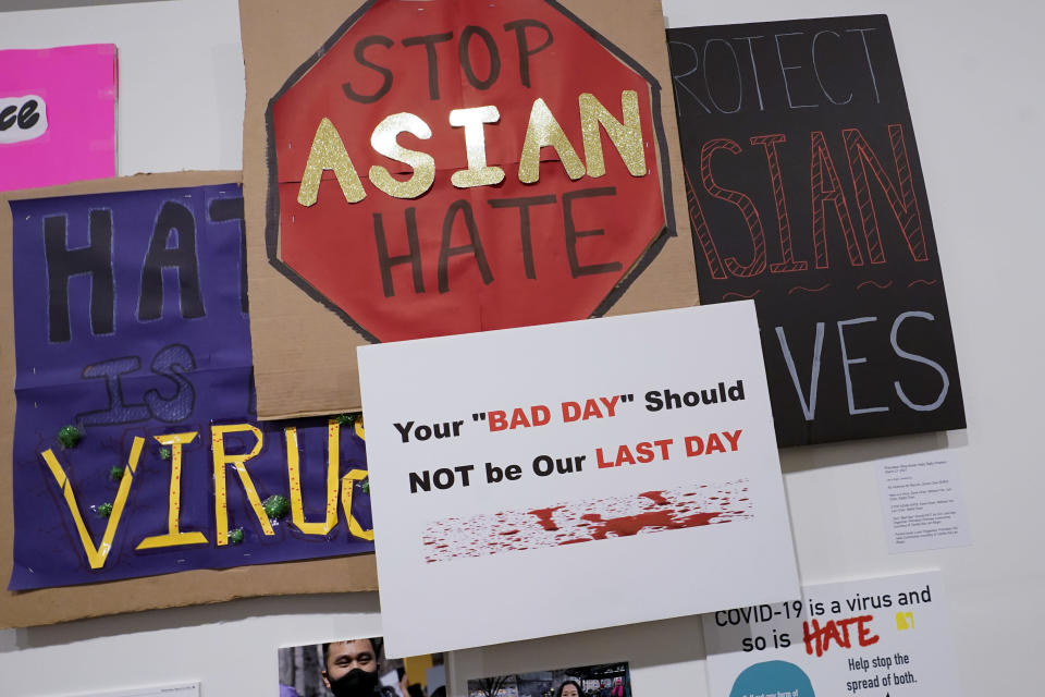 """Signs used during anti Asian hate protests are seen on display during the press preview of """"Responses: Asian American Voices Resisting the Tides of Racism"""" at the Museum of Chinese in America, Wednesday, July 14, 2021, in New York. (AP Photo/Mary Altaffer)"""
