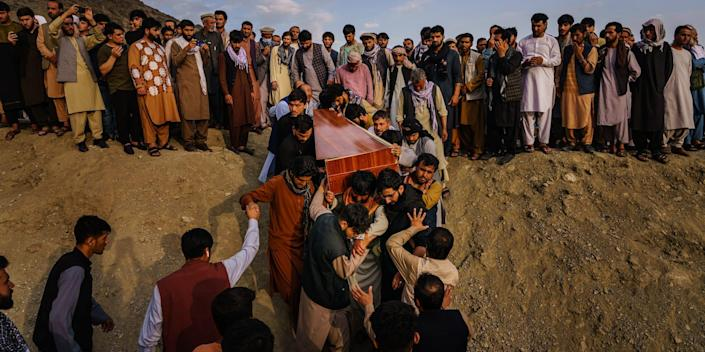 People carry a casket at a funeral in Afghanistan.