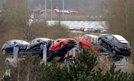 FILE PHOTO: New Toyota cars are transported from their manufacturing facility in Burnaston, Britain March 16, 2017. REUTERS/Darren Staples/File Photo