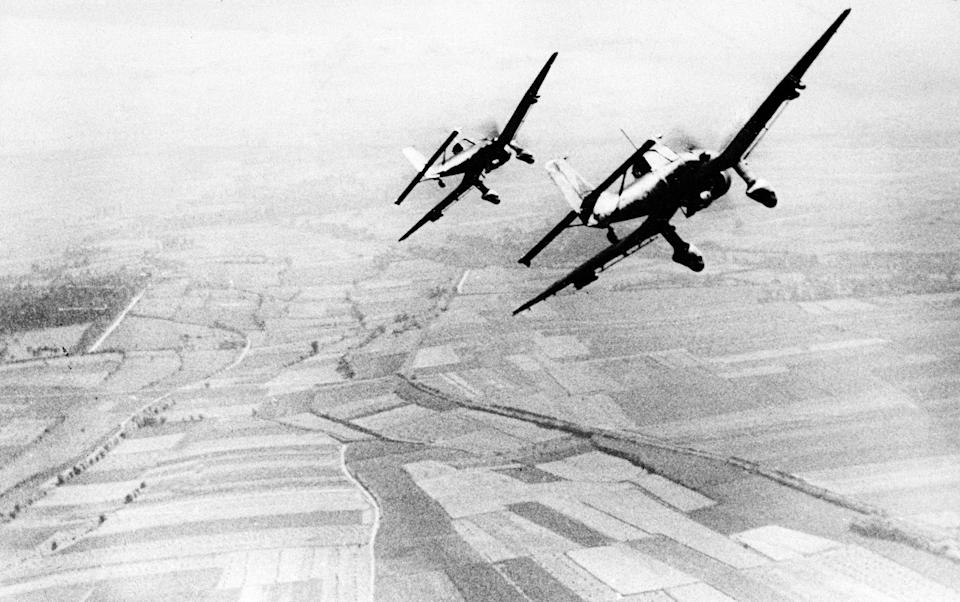 Two German Luftwaffe dive bombers of the type Ju 87 Stuka are seen returning from an attack against the British south coast, during the Battle for Britain, on August 19, 1940. (AP Photo)