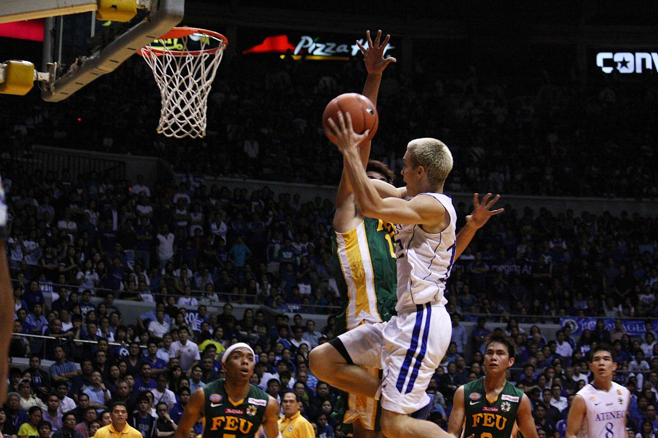 Kirk Long of Ateneo Blue Eagles goes for the basket during the UAAP Season 74 second game of the best-of-three championship series against FEU Tamaraws held at Smart Araneta Coliseum in Quezon City. (Marlo Cueto/NPPA Images)