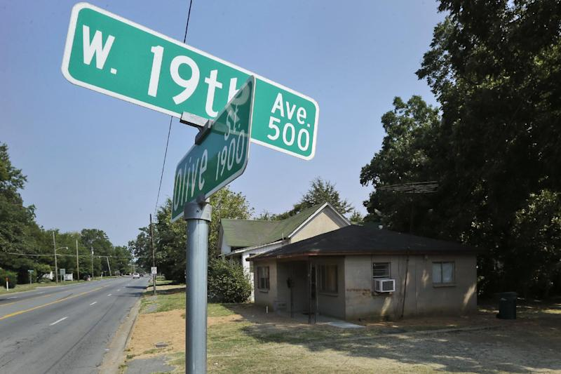 A house where Monroe Isadore once lived sits near an intersection Monday, Sept. 9, 2013, in Pine Bluff, Ark. Police said the 107-year-old man fired a weapon at police Saturday, Sept. 7, at a different location prompting officers to return fire. (AP Photo/Danny Johnston)