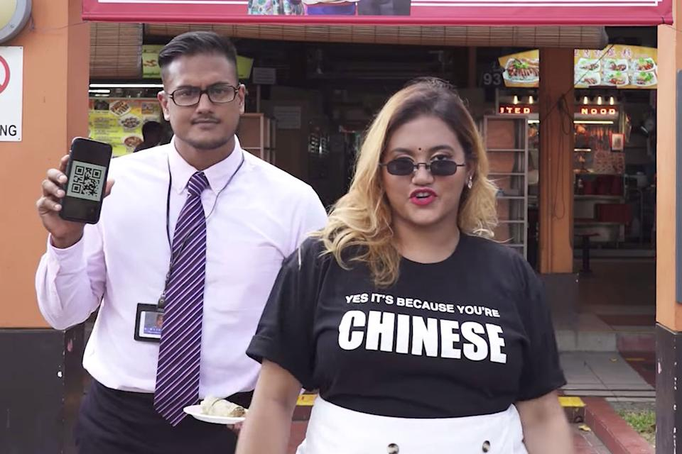 A screengrab from the music video posted on Facebook by the Nair siblings, in which the pair mocked a recent advertisement for an e-payment website. (PHOTO: Facebook / Preetipls)