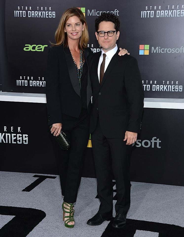 "HOLLYWOOD, CA - MAY 14:  Director/Producer J.J. Abrams (R) and wife Katie McGrath attend the premiere of Paramount Pictures' ""Star Trek Into Darkness"" at Dolby Theatre on May 14, 2013 in Hollywood, California.  (Photo by Jason Kempin/Getty Images)"