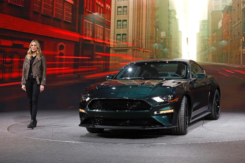Molly McQueen, the granddaughter of actor Steve McQueen, introduces the 2018 Ford Mustang Bullitt as it makes its debut at the 2018 North American International Auto Show on January 14, 2018 in Detroit, Michigan (AFP Photo/BILL PUGLIANO)