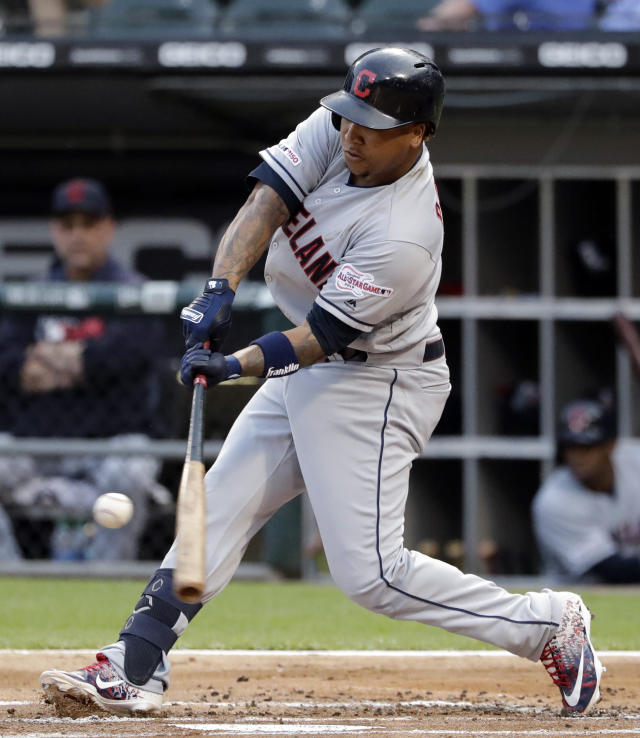 Cleveland Indians' Jose Ramirez hits a double against the Chicago White Sox during the first inning of a baseball game in Chicago, Friday, May 31, 2019. (AP Photo/Nam Y. Huh)