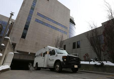 A police transport vehicle leaves the John Sopinka Courthouse, where Karim Baratov appeared in front of a judge in Hamilton, Ontario, Canada March 15, 2017 in connection with a U.S. Justice Department investigation into the 2014 hacking of Yahoo. REUTERS/Peter Power