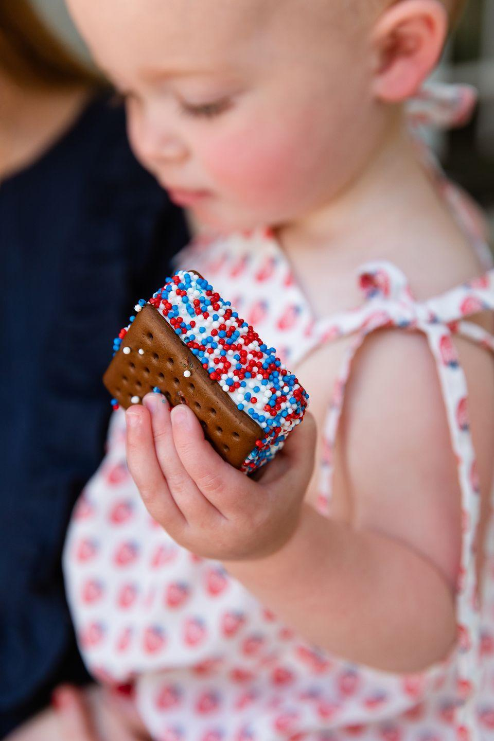 """<p><strong>What are your plans for the Fourth of July this year?</strong></p><p>We haven't really discussed how we are going to handle the Fourth yet. We usually throw a big party every year, so depending on health regulations, we will hopefully get to throw a family-oriented party outdoors. We live in Franklin, Tennessee, and the Franklin fireworks are shot essentially in our backyard on the Fourth every year, so we all sit on quilts and watch them together. I just want people to feel like they can take off their shoes and relax. And that's what the Fourth of July is all about. I like to serve simple food, like hamburgers and hot dogs, but I'll make some homemade relish and unique toppings that make it special. </p><p><strong>What are a few of your top summer entertaining tips?</strong></p><p>I always set up the food indoors. I just think it's near impossible to set up a buffet outside and not have to worry about it the whole time. People will be in and out anyways. </p><p>I also always set up something outside for the kids to keep them from wandering around the house and within sight, like a bubble machine or craft. Last year we made hand-printed T-shirts that looked like American flags that the kids put on in time for the fireworks once they dried. Sprinklers are always fun too!</p><p>I like to keep a bucket of """"guest comfortability"""" items outside, like bug spray, sunscreen, wipes, bandage, so that parents can grab them as needed, and you're not having to run in and out of the house when you're trying to make a cocktail and breathe. </p>"""