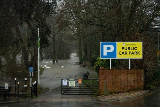 A car park is covered with water after the River Severn burst its banks in Worcester (Jacob King/PA)