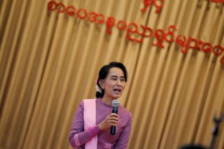 Myanmar pro-democracy leader Aung San Suu Kyi gives a speech as she meets with local authors and publishers at a restaurant in Yangon