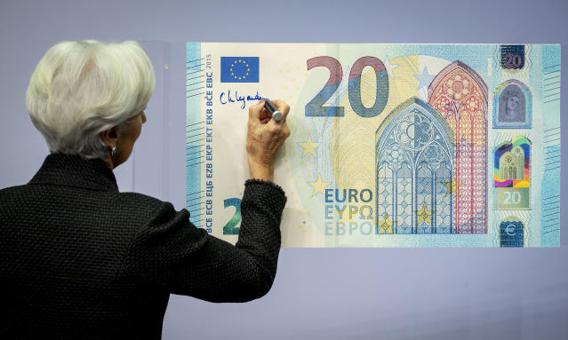 The new President of the European Central Bank Christine Lagarde adds her signature to an oversize euro banknote at the ECB in Frankfurt, Germany, on 27 November 2019. (Michael Probst/AP)
