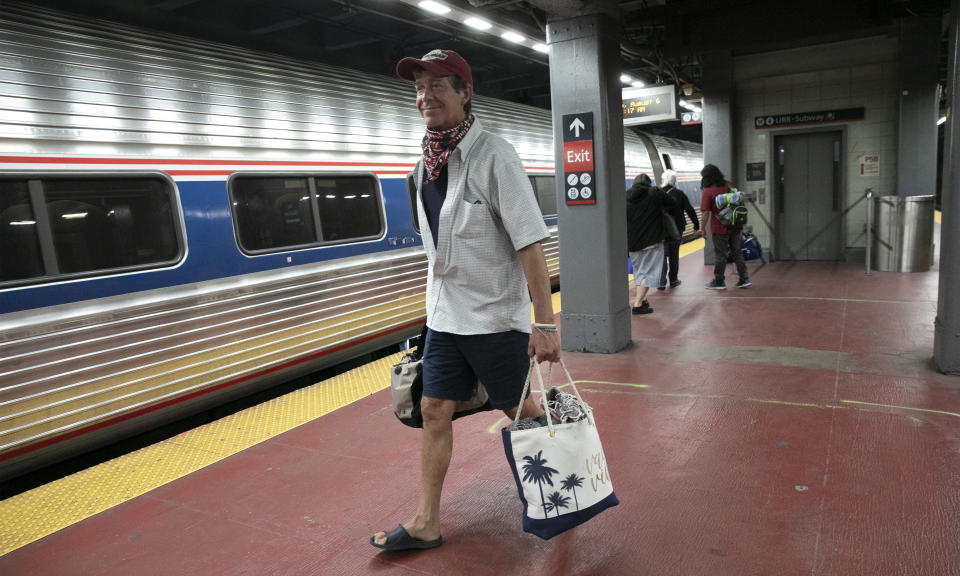 "Timothy Mahyna arrives on a train from Georgia at Amtrak's Penn Station, Thursday, Aug. 6, 2020, in New York. Mayor de Blasio is asking travelers from 34 states, including Georgia where COVID-19 infection rates are high, to quarantine for 14 days after arriving in the city. Mahyna, from Syracuse, N.Y., said, ""I will probably quarantine for a week when I get home."" (AP Photo/Mark Lennihan)"