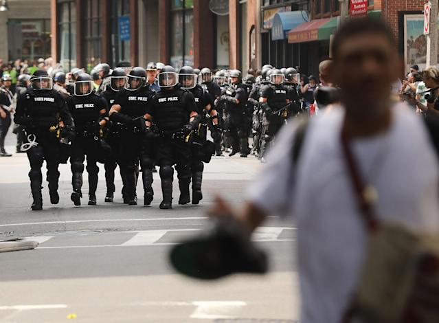 <p>Protesters face off with riot police escorting conservative activists following a march in Boston against a planned 'Free Speech Rally' just one week after the violent 'Unite the Right' rally in Virginia left one woman dead and dozens more injured on August 19, 2017 in Boston Mass. (Photo: Spencer Platt/Getty Images) </p>