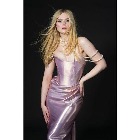 "<p>Elle Fanning wore a custom-made Vivienne Westwood gown, inspired by her The Great character, Catherine The Great's love of pearls. </p><p><a href=""https://www.instagram.com/p/CN_YM-jFVIN/"" rel=""nofollow noopener"" target=""_blank"" data-ylk=""slk:See the original post on Instagram"" class=""link rapid-noclick-resp"">See the original post on Instagram</a></p>"