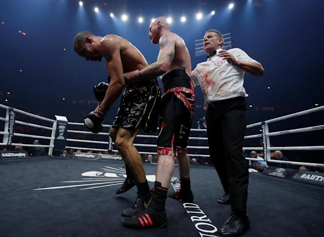Boxing - World Boxing Super Series Semi Final - George Groves vs Chris Eubank Jr - WBA & IBO World Super-Middleweight Titles - Manchester Arena, Manchester, Britain - February 17, 2018 Referee Michael Alexander separates George Groves and Chris Eubank Jr Action Images via Reuters/Andrew Couldridge