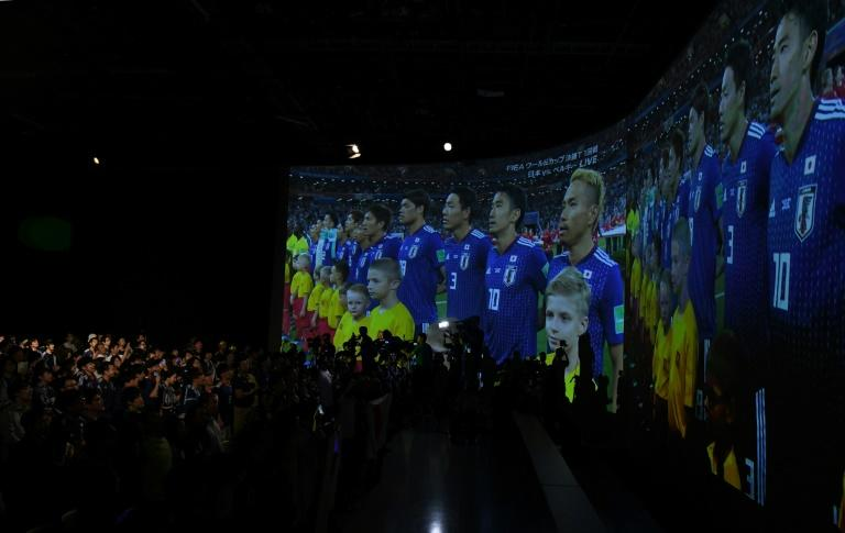 Japanese supporters had gathered in bars and at big screens across the country to watch the last 16 clash