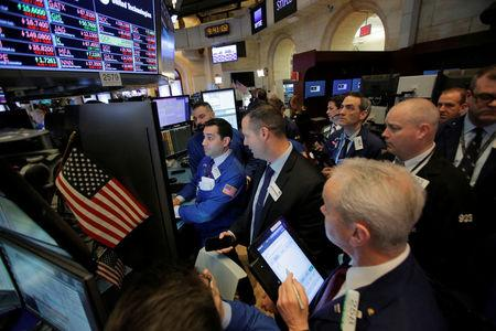 Traders work on the floor at the New York Stock Exchange (NYSE) in Manhattan, New York City, U.S., March 2, 2018. REUTERS/Andrew Kelly