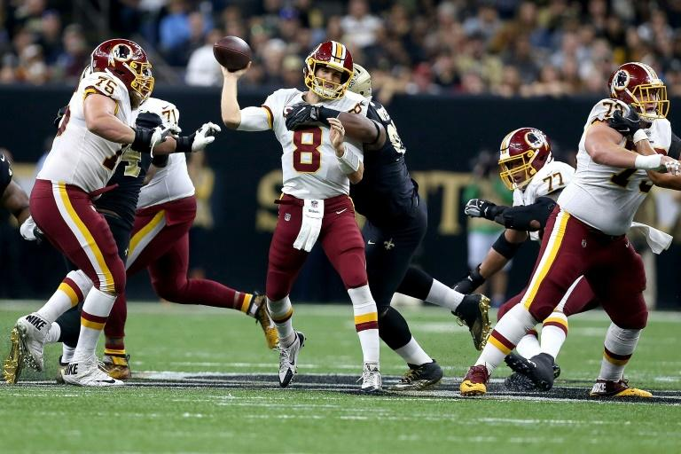 Kirk Cousins of the Washington Redskins is sacked by David Onyemata of the New Orleans Saints during the first half at the Mercedes-Benz Superdome