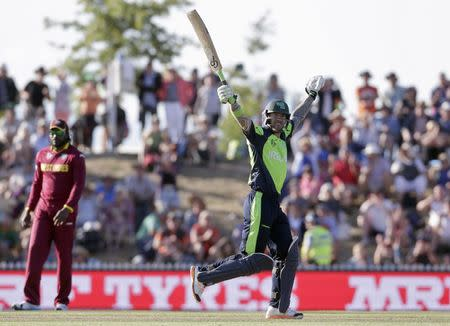 Ireland's Mooney celebrates hitting the winning runs as they beat the West Indies for the first time in their Cricket World Cup match in Nelson