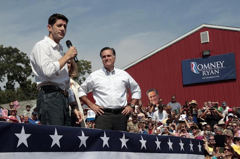 Republican presidential candidate, former Massachusetts Gov. Mitt Romney, right, listens and Republican vice presidential candidate, Rep. PaulRyan, R-Wis., speaks during a campaign event at the Long Family Farm, Orchard & Cider Mill, Friday, Aug. 24, 2012 in Commerce, Mich.  (AP Photo/Mary Altaffer)