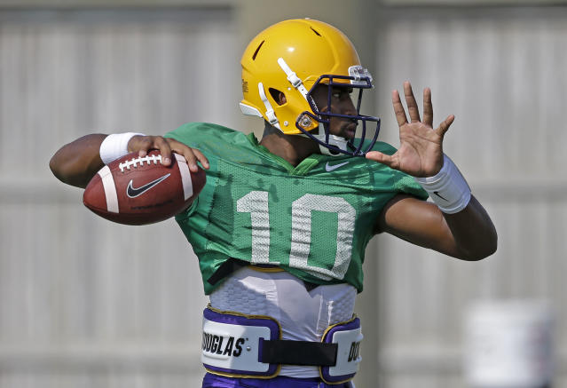 FILE - In this Aug. 6, 2014, file photo, LSU quarterback Anthony Jennings (10) passes during their NCAA college football practice in Baton Rouge, La. Tigers coach Les Miles has declared that he will use both sophomore Jennings and freshman Brandon Harris. (AP Photo/Gerald Herbert, File)