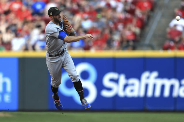 Los Angeles Dodgers' Chris Taylor fields and throws out Cincinnati Reds' Jesse Winker at first base in the eighth inning of a baseball game, Saturday, May 18, 2019, in Cincinnati. (AP Photo/Aaron Doster)