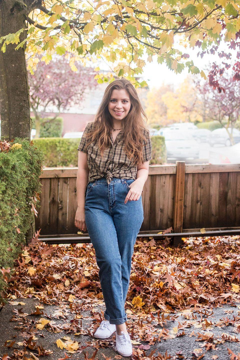 """<p>If you grew up watching <em>Boy Meets World</em>, you either had a crush on Topanga or you wanted to be her. Mimic her effortless style with a pair of mom jeans, sneakers and a tied plaid shirt. </p><p><em><a href=""""https://www.hellorigby.com/90s-costume-ideas/"""" rel=""""nofollow noopener"""" target=""""_blank"""" data-ylk=""""slk:Get the tutorial at Hello Rigby >>"""" class=""""link rapid-noclick-resp"""">Get the tutorial at Hello Rigby >></a></em></p>"""