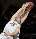 Notre Dame's John Mooney (33) battles for a rebound with Boston College's Nik Popovic during the first half of an NCAA college basketball game Saturday, Jan. 12, 2019, in South Bend, Ind. (AP Photo/Robert Franklin)