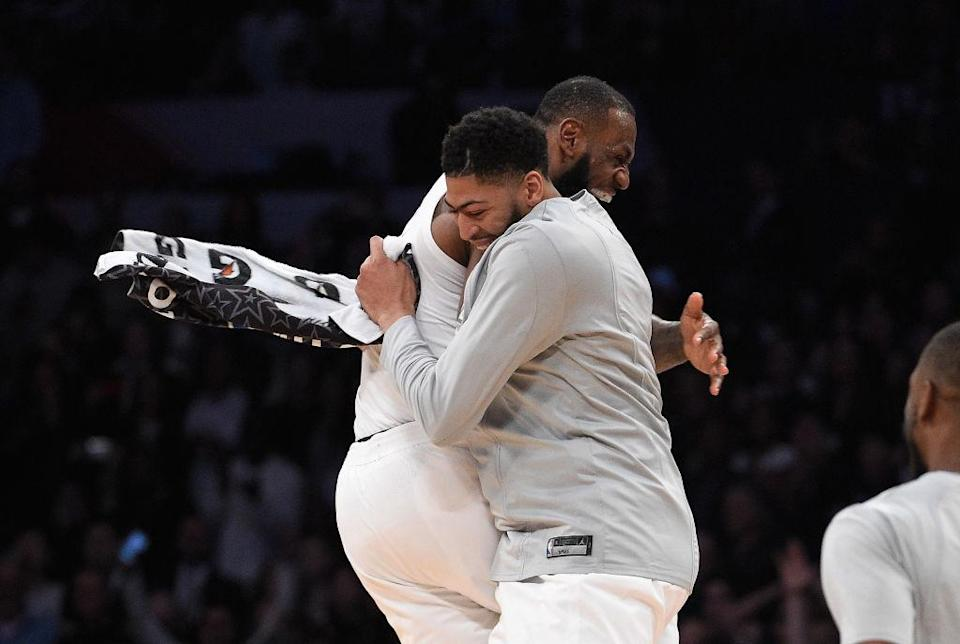LeBron James and Anthony Davis share an embrace at the All-Star Game in February. (Getty Images)