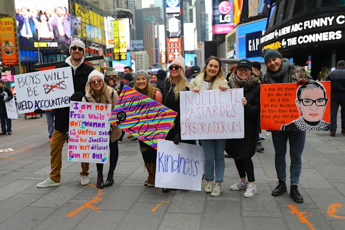 Taryn Luby (third from left) poses with friends in Times Square after the Women's March. (Photo: Gordon Donovan/Yahoo News)