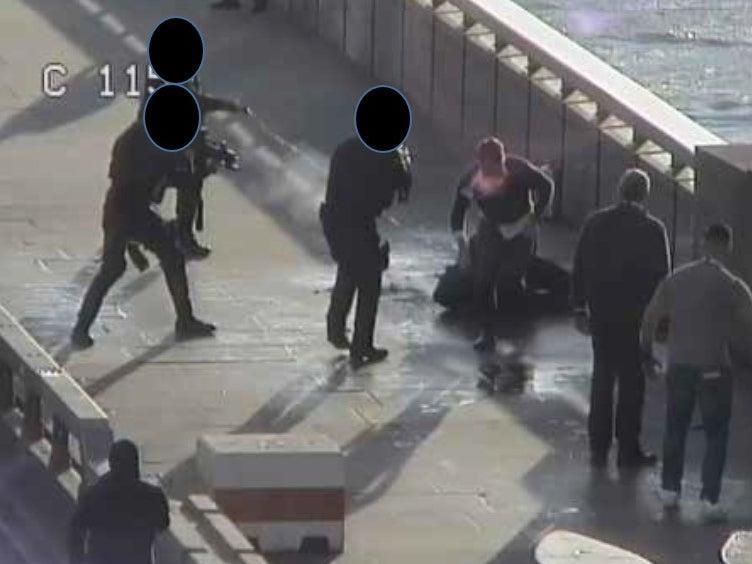 A still from CCTV footage showing armed police officers confronting Usman Khan after he was subdued by members of the public (Metropolitan Police )