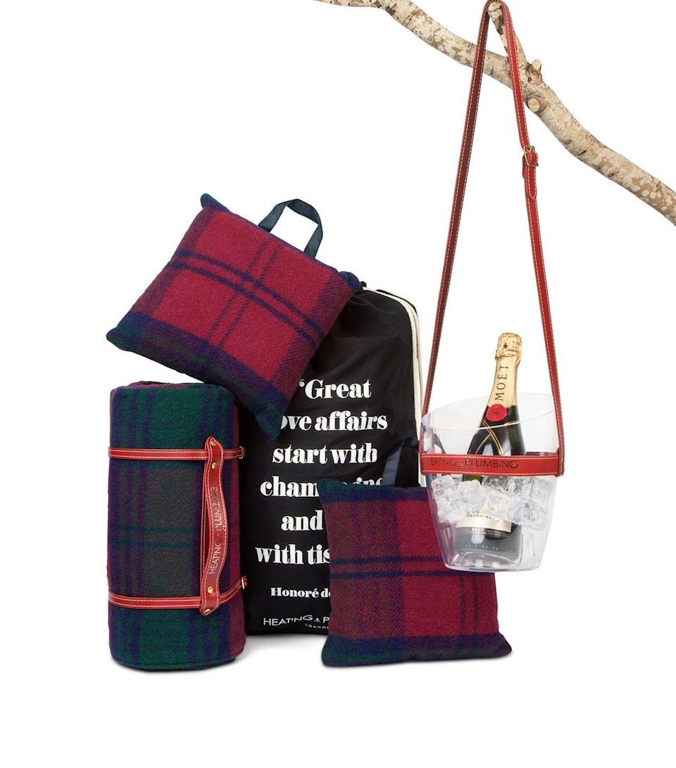 """<p>Bringing a splash of colour to your picnic, Heating & Plumbing's classic red, green and navy check wool blanket (complete with a waterproof backing), two cushions and a handy portable Champagne cooler, the Highland Dream Ultimate Picnic Tool Kit will see you through all the warm summer days. FC</p><p>£335, <a href=""""https://www.harrods.com/en-gb/shopping/classic-hunting-lodge-ultimate-picnic-tool-kit-16521190?utm_source=google_uk&utm_medium=shopping&utm_campaign=home_and_furniture&utm_content=heating_&_plumbing_16521190-7983&gclid=CjwKCAjwj6SEBhAOEiwAvFRuKDJynB1tFWJuCCL96DaZw1ju_XGbPs1IXTpgq2L7iZYPOxIJNeElrxoCyU0QAvD_BwE&gclsrc=aw.ds"""" rel=""""nofollow noopener"""" target=""""_blank"""" data-ylk=""""slk:Harrods"""" class=""""link rapid-noclick-resp"""">Harrods</a>.<br></p>"""