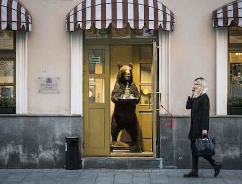 A stuffed bear proffers vodka at a shop in Moscow - Credit: GETTY