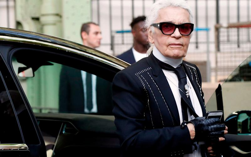 German fashion designer for Chanel, Karl Lagerfeld arriving for the Chanel women's 2018 Spring/Summer ready-to-wear collection fashion show in Paris. - AFP