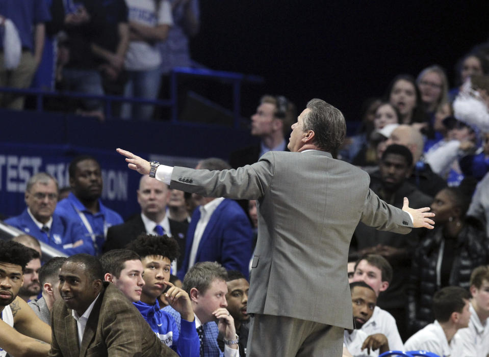 """Kentucky coach John Calipari tries to quiet the crowd as chants of """"overrated"""" erupt during the second half of his team's NCAA college basketball game against Tennessee in Lexington, Ky., Saturday, Feb. 16, 2019. Kentucky won 86-69. (AP)"""
