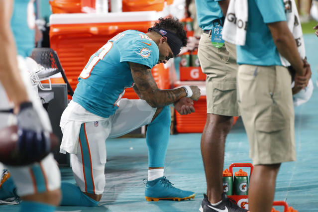 Miami Dolphins wide receiver Kenny Stills kneels during the singing of the national anthem before an NFL football preseason game against the Jacksonville Jaguars, Thursday, Aug. 22, 2019, in Miami Gardens, Fla. (AP Photo/Wilfredo Lee)