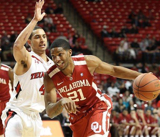 Oklahoma's Cameron Clark drives against Texas Tech's Ty Nurse during their NCAA college basketball game in Lubbock, Texas, Saturday, Feb. 11, 2012. (AP Photo/Lubbock Avalanche-Journal, Zach Long) ALL LOCAL TV OUT
