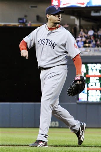 Boston Red Sox pitcher Josh Beckett yells toward plate umpire Adrian Johnson over a call as he leaves the field in the first inning against the Minnesota Twins in a baseball game, Tuesday, April 24, 2012, in Minneapolis. (AP Photo/Jim Mone)