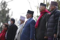 Nepalese leaders of the splinter group in the governing Nepal Communist Party sing the national anthem during a protest in Kathmandu, Nepal, Friday, Jan. 22, 2021. Thousands of demonstrators rallied in Nepal's capital Friday protesting against the prime minister who had dissolved the parliament and ordered fresh election because of feuds within the ruling political party. (AP Photo/Niranjan Shrestha)