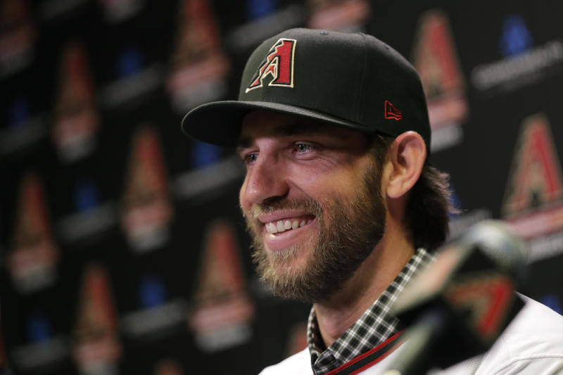 Newly acquired Arizona Diamondbacks pitcher Madison Bumgarner speaks after being introduced during a team availability, Tuesday, Dec. 17, 2019, in Phoenix. (AP Photo/Matt York)