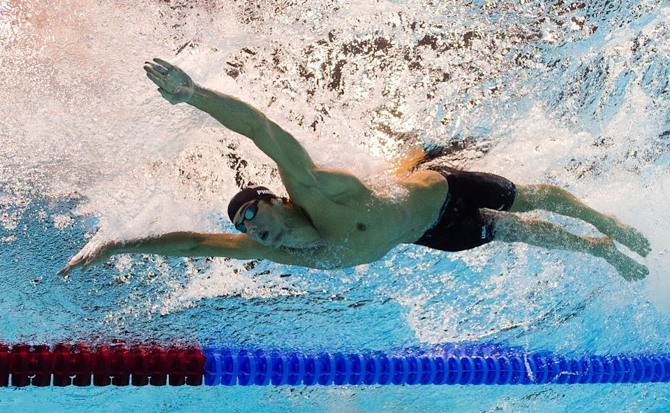 In a picture taken with an underwater camera US swimmer Michael Phelps competes in the men's 200m butterfly semi-final swimming event at the London 2012 Olympic Games on July 30, 2012 in London.  AFP PHOTO / FRANCOIS XAVIER MARIT        (Photo credit should read FRANCOIS XAVIER MARIT/AFP/GettyImages)