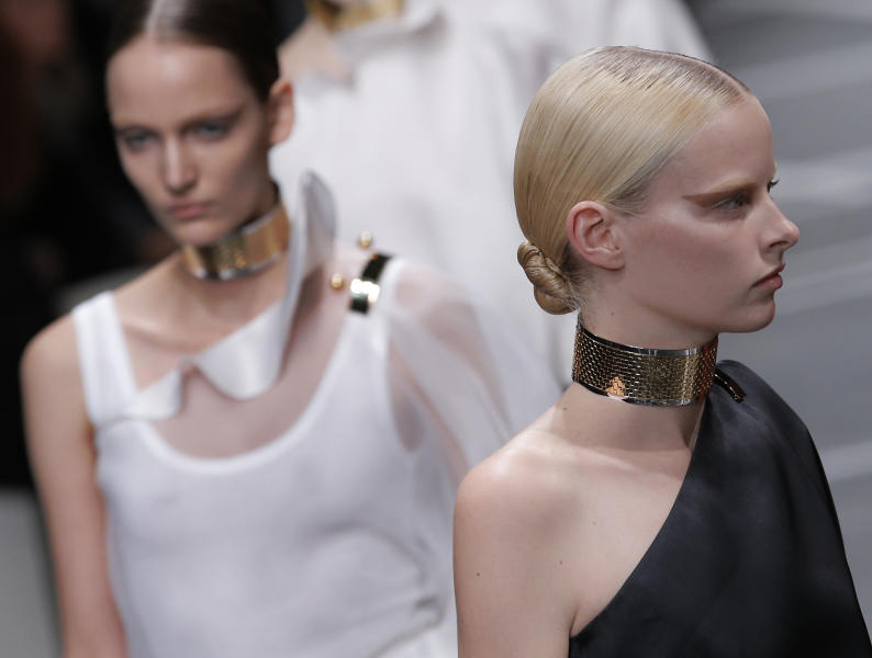 A model wears a creation by fashion designer Riccardo Tisci for Givenchy's ready to wear Spring-Summer 2013 collection, presented in Paris, Sunday, Sept. 30, 2012. (AP Photo/Francois Mori)