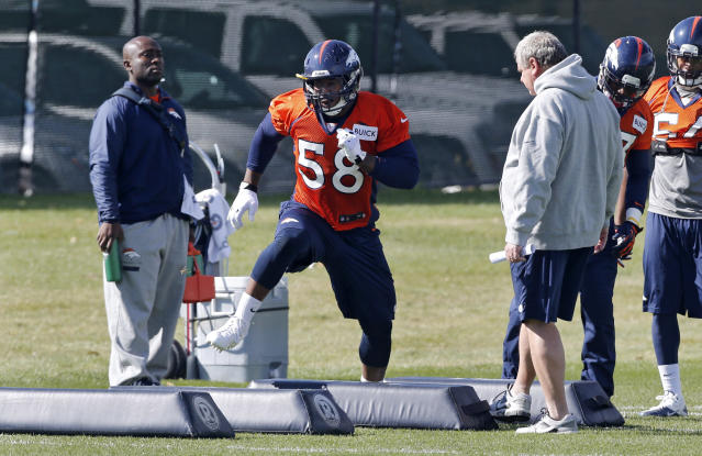 Denver Broncos linebacker Von Miller works out during practice at the NFL football team's practice facility in Englewood, Colo., on Wednesday, Oct. 16, 2013. It was the first practice with the team for Miller since August as he completed a six game suspension for violating the leagues substance abuse rules. (AP Photo/Ed Andrieski)