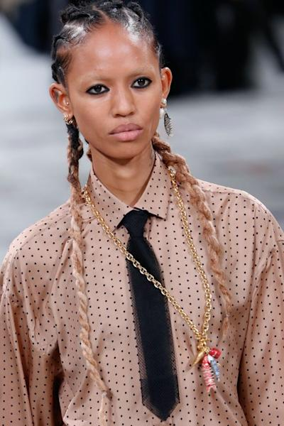 Bold, graphic eyeliner stole the show at Dior, exaggerated by lightened brows and scrubbed-clean complexions