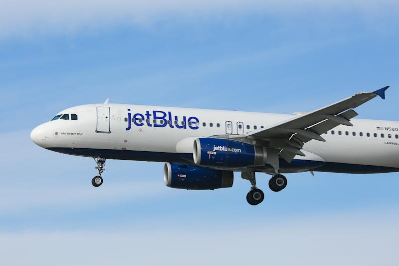 JetBlue Airways Airbus A320-200 aircraft as seen on final approach landing at New York John F. Kennedy International Airport in USA. The airplane has the registration N580JB, 2x IAE jet engines and the name Mo Better Blue . Jet Blue B6 JBU is an American low cost airline carrier with a fleet of 256 airliners and headquarters in Long Island City in NYC borough of Queens with main hub base JFK KJFK airport. (Photo by Nicolas Economou/NurPhoto via Getty Images)