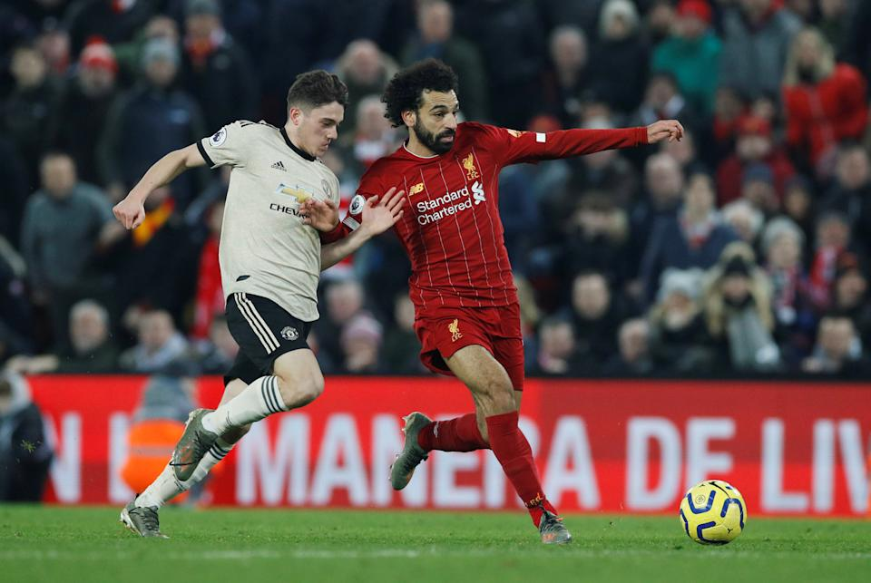 Liverpool's Mohamed Salah (right) battles for the ball with Manchester United's Daniel James.